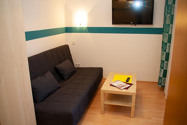 Familienzimmer im Hotel Zlami-Holzer mit Bettcouch